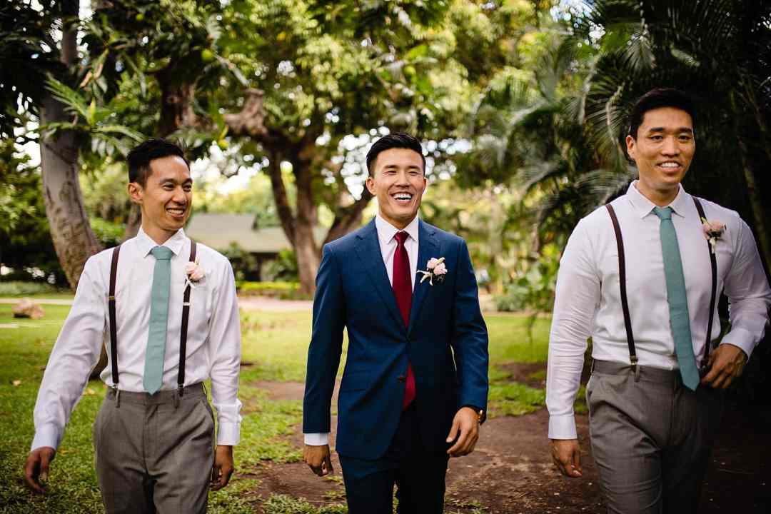 groom and groomsmen walking to first look at Olowalu Plantation House