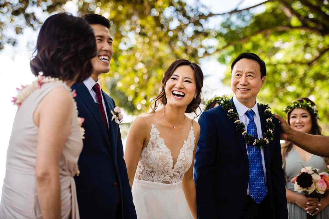 bride laughing during ceremony at Olowalu Plantation House
