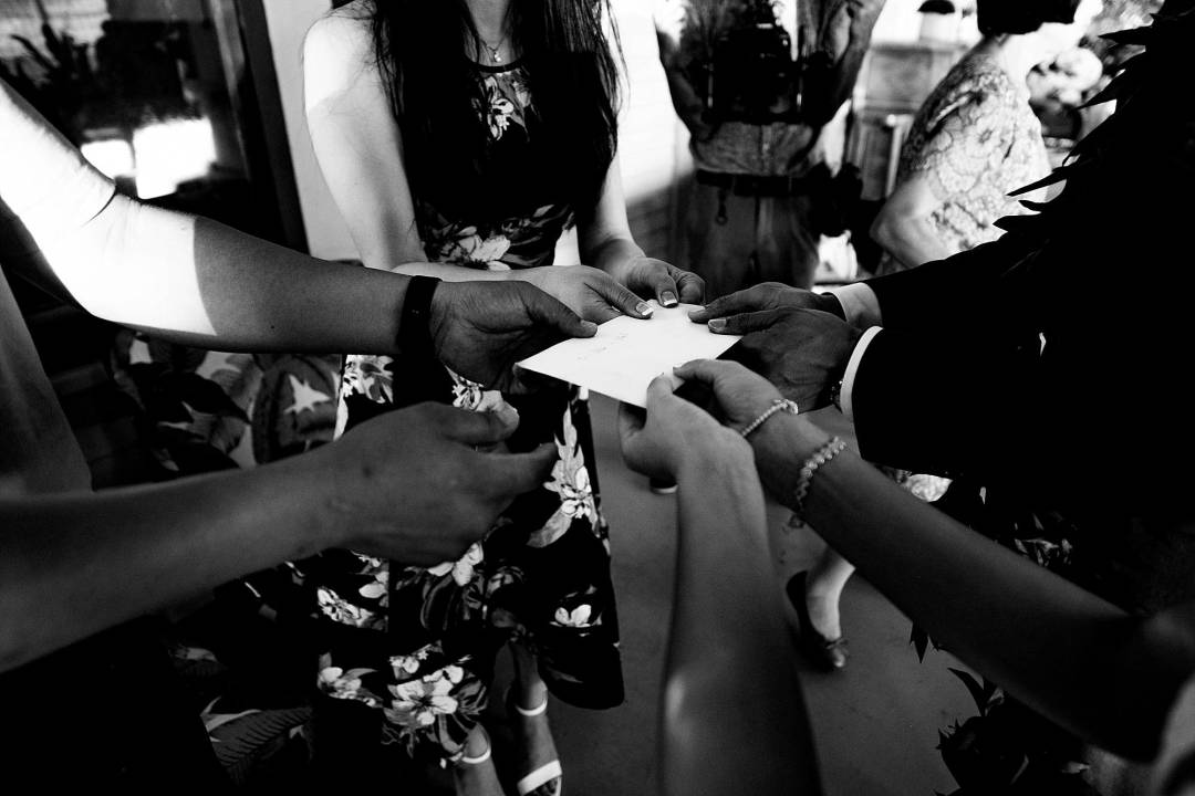 bride and groom receiving gift from family at Olowalu Plantation House