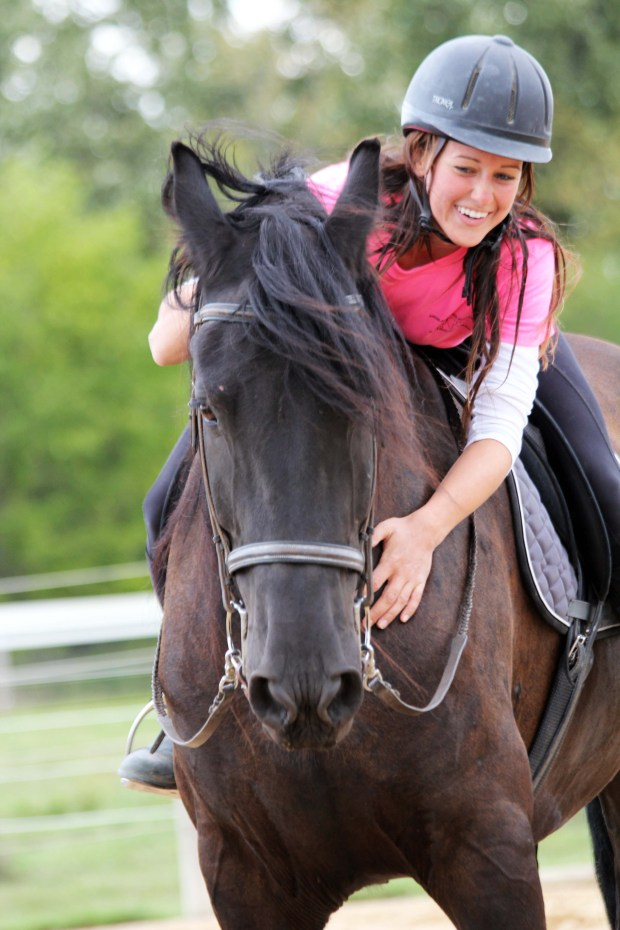 Angela riding clients horse