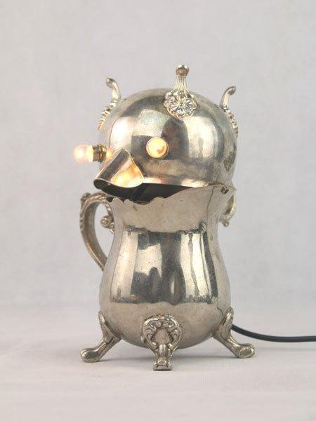Cojent. Animal lumineux, assemblage d'un service en argent.