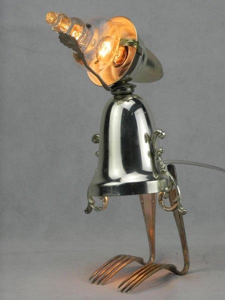 Poinchette. Assemblage de métal patiné, argent. Avec une coupe de sport, un verre, une petite cuillère et deux fourchettes en argent,