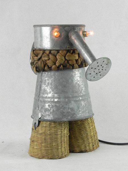 Galsier. Sculpture assemblage d'un arrosoir, un seau et deux cache-pots. Métal galvanisé et fibres naturelles.