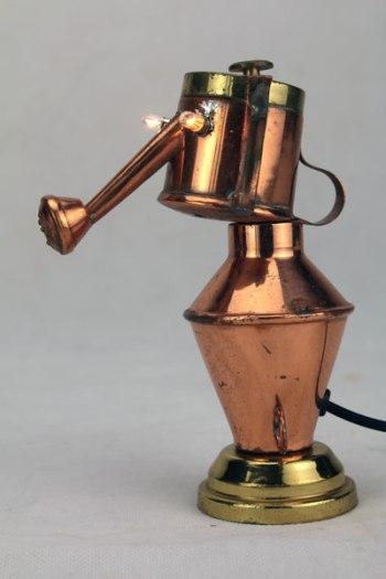 Mini sculpture lumineuse en cuivre.
