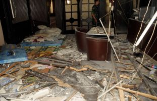Damage is seen after a suicide bombing at a Syrian Army Nadi Al Dobat in Aleppo