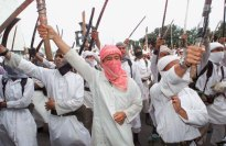 Hundreds of members of Laskar Jihad, or Holy War fighters, wave their swords during a demonstration in Jakarta in this Monday, April 10, 2000 photo. Laskar Jihad, Indonesia's most violent Muslim extremist group which is blamed for the slaughter of thousands of Christians in a sectarian conflict in the Maluku islands, has disbanded, the group's legal adviser said Tuesday, Oct. 15, 2002. (AP Photo/Dita Alangkara)