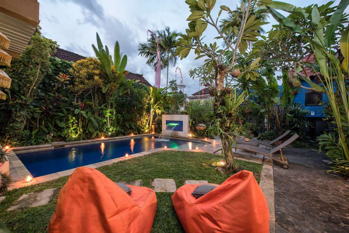 Relax by the pool day or night at Angel House Ubud