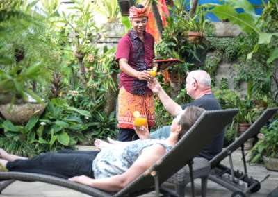 Angel House Ubud staff serving drinks by the pool