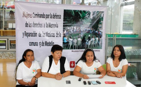 Members of the Comuna 13-based victims organization Women Walking for Truth present a statement at an October 14 press conference.