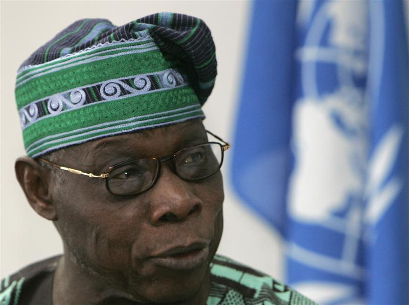 Nigeria's former president Olusegun Obasanjo speaks during the official opening of peace talks between the Congolese government and the eastern Congolese rebel group of General Laurent Nkunda at the U.N. headquarters in Nairobi December 8, 2008. REUTERS/Antony Njuguna (KENYA)