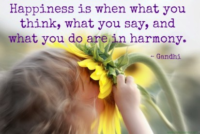 Gandhi about happiness - picture quote - child with sunflower