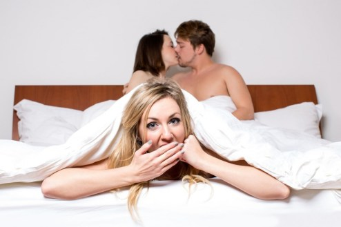in bed with cheating partner