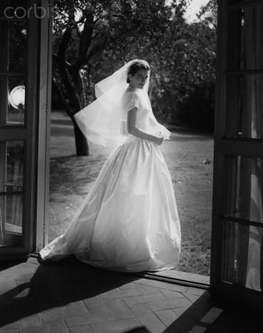 Bride at porch doors, 1952. da/from www.corbis.com