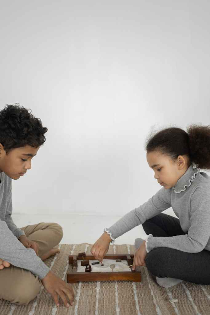 ethnic kids playing with toys on floor