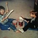 Boys Playing Toy Drums