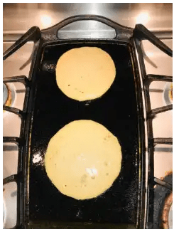 pancake cooking on pan with bubbles