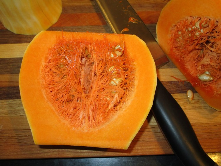scoop out seeds from butternut squash