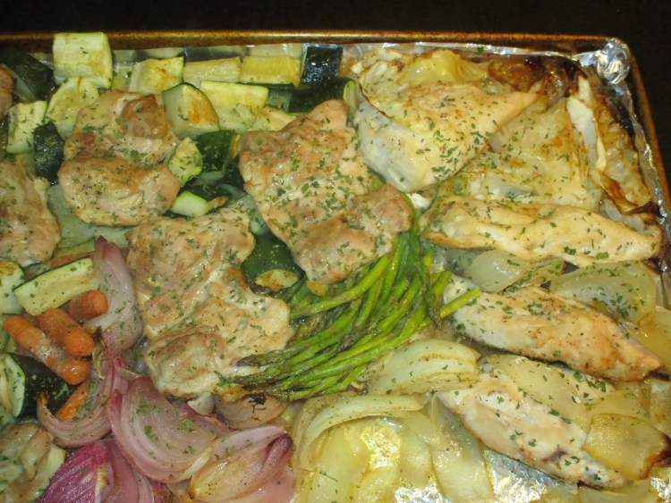 chicken and veggies on sheet pan out of oven