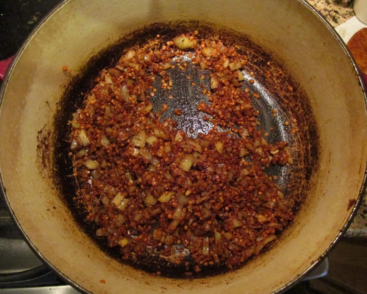 spices all mixed into lentils and onion for vegan chili
