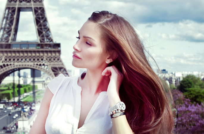 Beautiful woman in Paris near the Eiffel tower