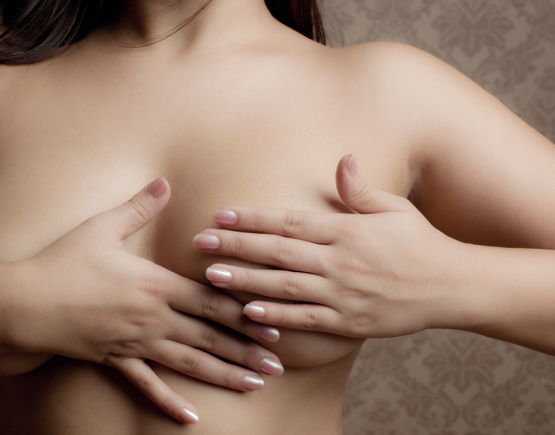 Young woman doing a self breast exam