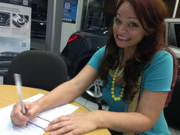 Writing a big check for Sheila