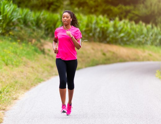 African american woman runner jogging outdoors - Fitness, peopl