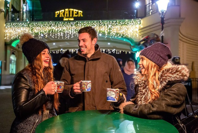 Standing around the table at the Christmas market drinking Glühwein (hot mulled Red Wine)