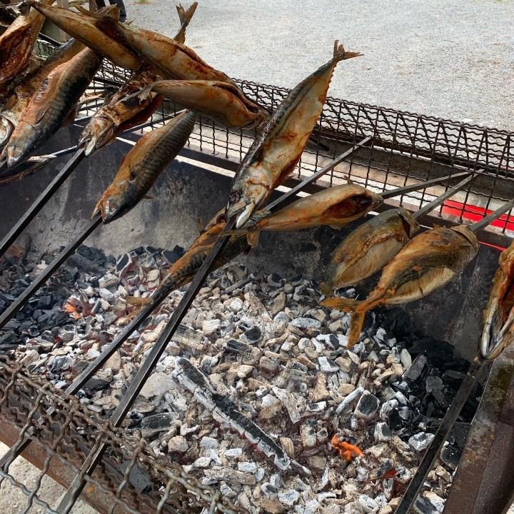Steckerlfisch. Spanish Makrele, Fish on a stick grilled