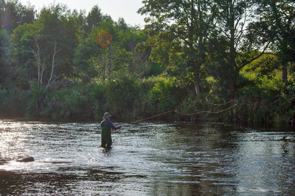 wading in the river fly casting
