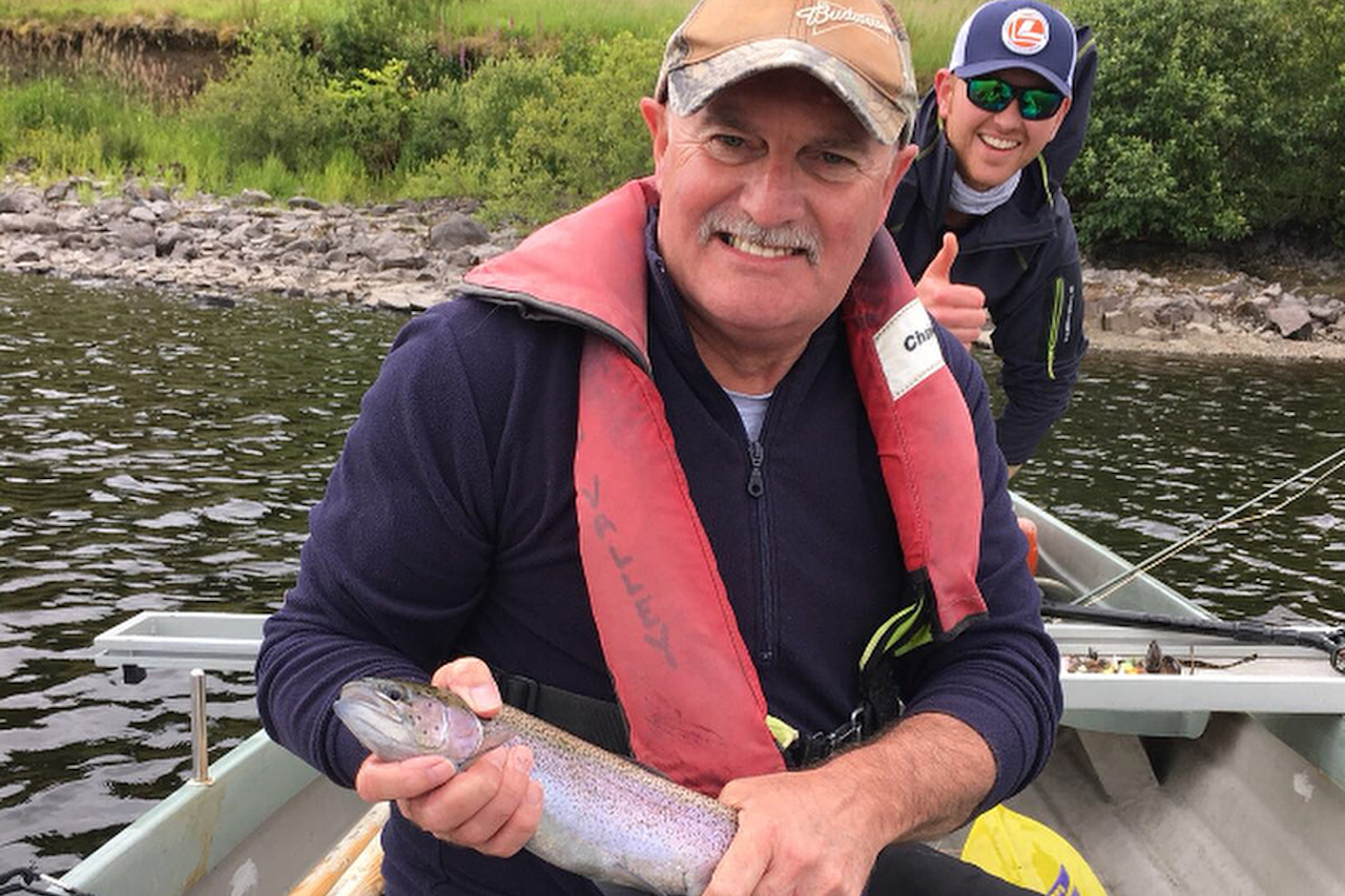Father and son family fishing trip for rainbow trout
