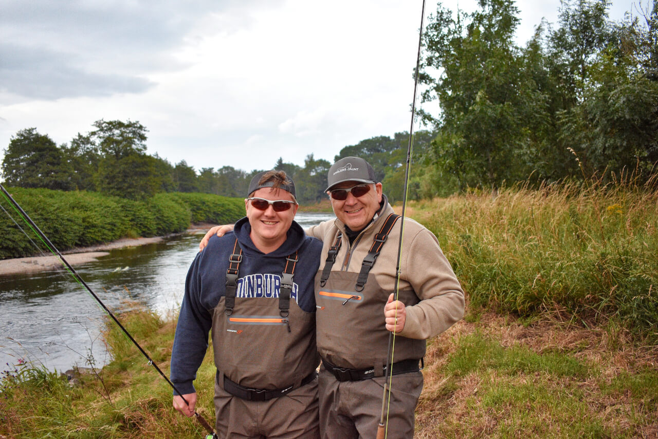 father and son fishing during holiday in scotland