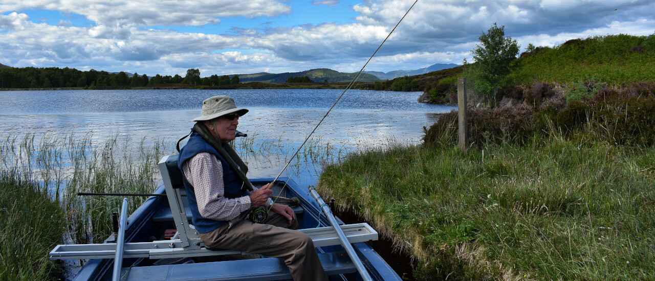 man on boat during fishing holiday in scotland