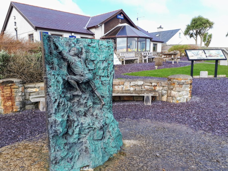 A statue outside Moelfre sea watch depicting Joseph Rogers daring rescue attempt (Royal Charter clipper sinking at Moelfre)