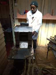 Anthony and his sugarcane cutting machine, financed by the KCDT