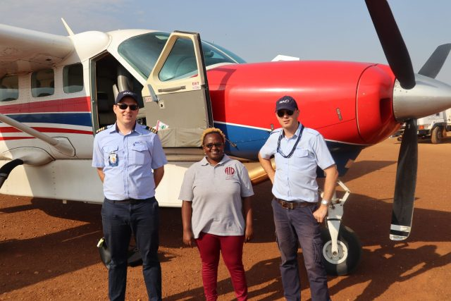 Tabitha with MAF pilots