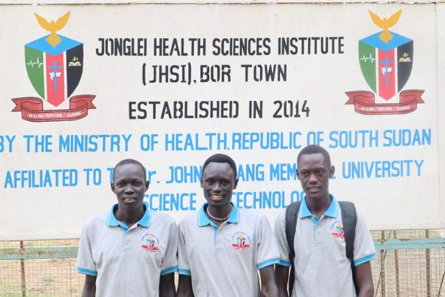 JHSI students in front of the JHSI sign