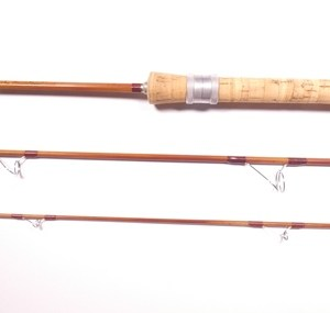 """An Orvis """"Rocky Mountain"""" 3 piece cane spinning rod,"""