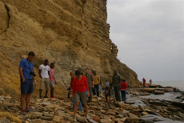 Looking for fossils at the foot of a sedimentary outcrop.