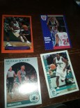 Dee Brown in a classic Raptors jersey. Derrick Coleman and Larry Johnson rookie cards. I bet those used to be worth something. Muggsy Bogues!
