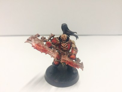 Champion of the unit, wielding the fearsome Goreglave. Besides the massive weapon, I wanted him to stand out from the rest of the unit by having him be soaked in the gore of his unfortunate victims (also adds debt to the unit).