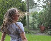 girls in backyard, raining