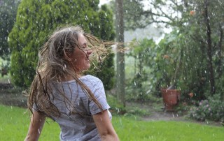 girls in backyard, raining