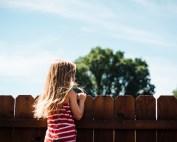 Girl in fenced backyard