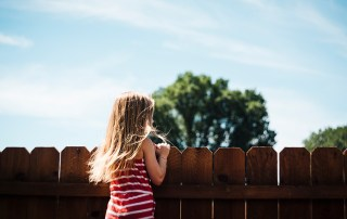 Girl in fenced backyard