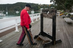 """That's Laurie stepping up to """"the stocks"""". The text on the timber says: """"Only for people with short legs"""""""
