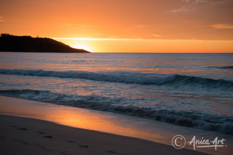 Sun rising over Bannisters Headland Mollymook
