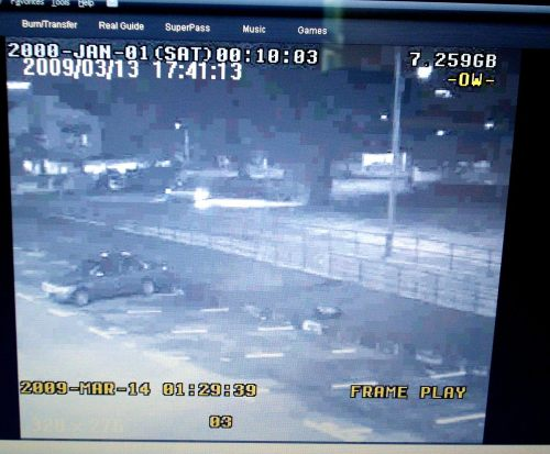 5-the-cctv-image-the-light-at-the-centre-of-picture-shows-the-car-parking-before-breaking-the-plaque