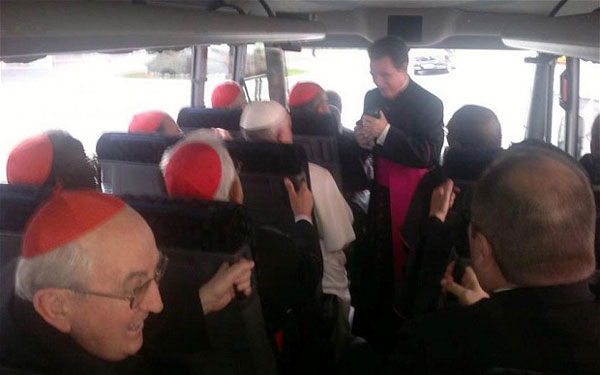 Pope Franics in a mini-bus