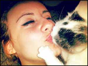 Image result for cat kissing a person